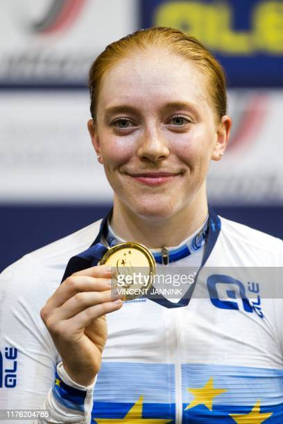 Winner British Emily Nelson holds her gold medal during the honoring of the women's scratch final at the European Championship Road Cycling in...