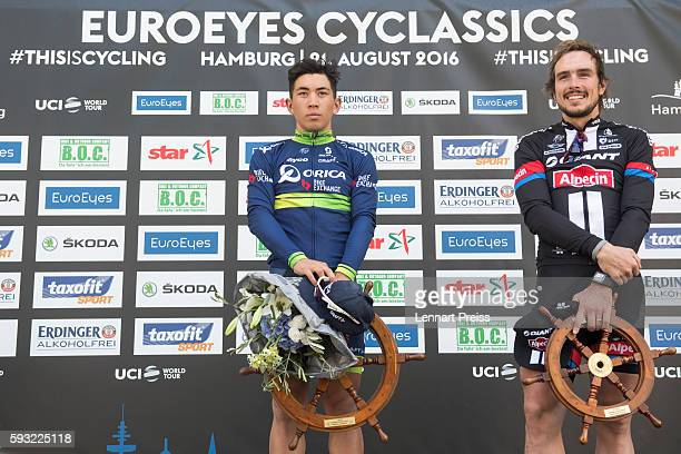 Winner Caleb Ewan from Australia and second placed John Degenkolb from Germany stand on the podium after the Euroeyes Cyclassics Hamburg on August 21...