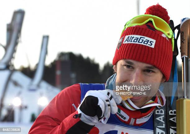 Winner Canada's Alex Harvey poses with the medal after the men's crosscountry 50 km freestyle mass start skiing competition in the FIS Nordic World...