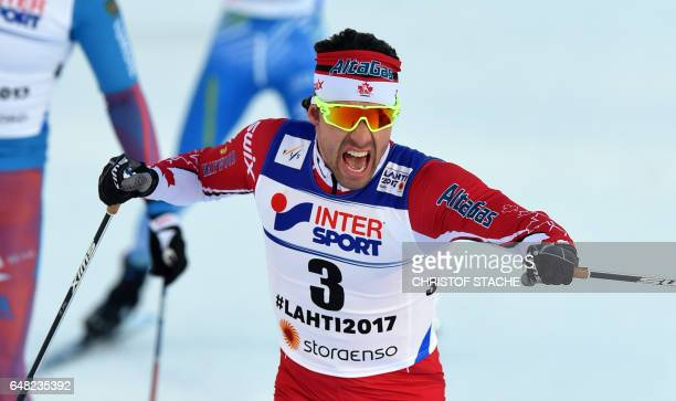 Winner Canada's Alex Harvey reacts after winning the men's crosscountry 50 km freestyle mass start skiing competition ahead in the FIS Nordic World...