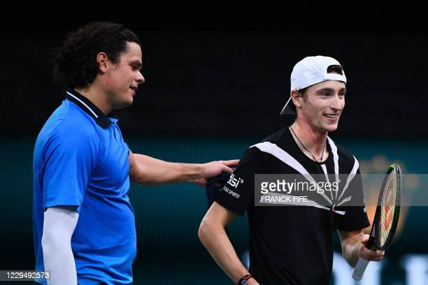 Winner Canada's Milos Raonic congratulates France's Ugo Humbert at the end of their men's singles quarter-final tennis match on day 5 at the ATP...