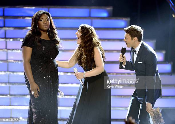 Winner Candice Glover finalist Kree Harrison and host Ryan Seacrest speak onstage during Fox's American Idol 2013 Finale Results Show at Nokia...