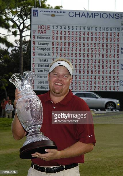 Winner Carl Pettersson poses with the champions trophy after the final round of the 2005 Chrysler Championship October 30 in Palm Harbor