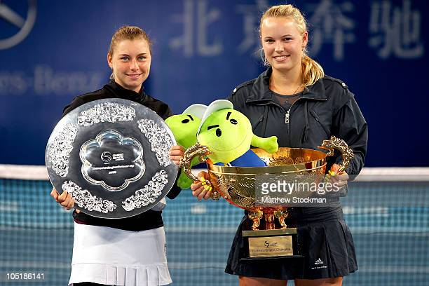 Winner Caroline Wozniacki of Denmark and Vera Zvonareva of Russia pose with their trophies after the Women's Singles final on day eleven of the 2010...