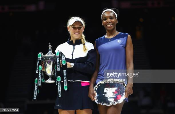 Winner Caroline Wozniacki of Denmark celebrates victory with the Billie Jean King trophy and runner up Venus Williams of the United States after the...