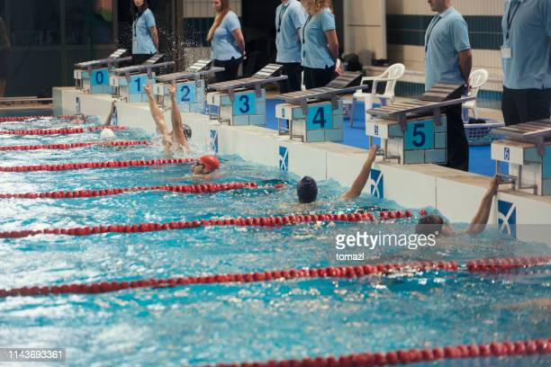 winner celebrating at swimming competition - judge sports official stock pictures, royalty-free photos & images
