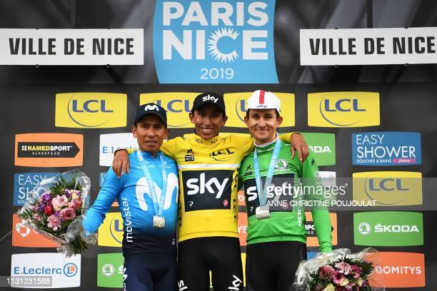 Winner Colombia's Egan Bernal celebrates his overall leader yellow jersey on the podium with second placed Colombia's Nairo Quintana and third placed...