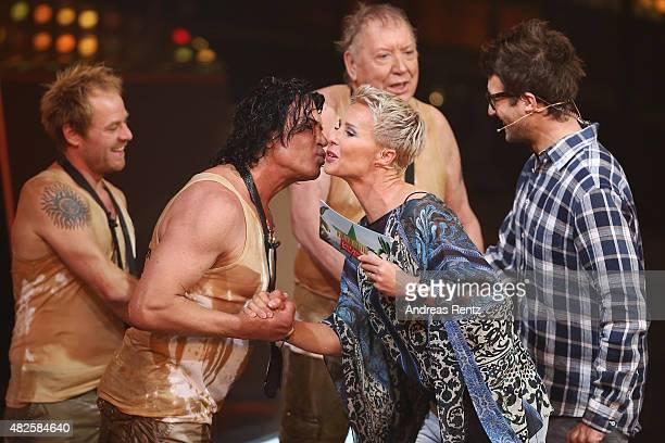Winner Costa Cordalis kisses TV host Sonja Zietlow during the 1st live show of the television show 'Ich bin ein Star lasst mich wieder rein' on July...