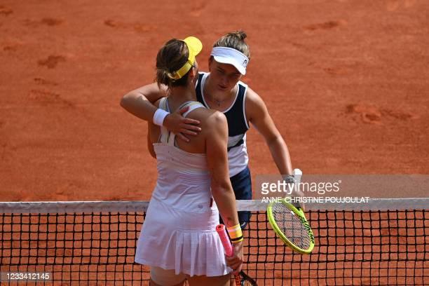 Winner Czech Republic's Barbora Krejcikova congratulates Russia's Anastasia Pavlyuchenkova at the end of their women's singles final tennis match on...