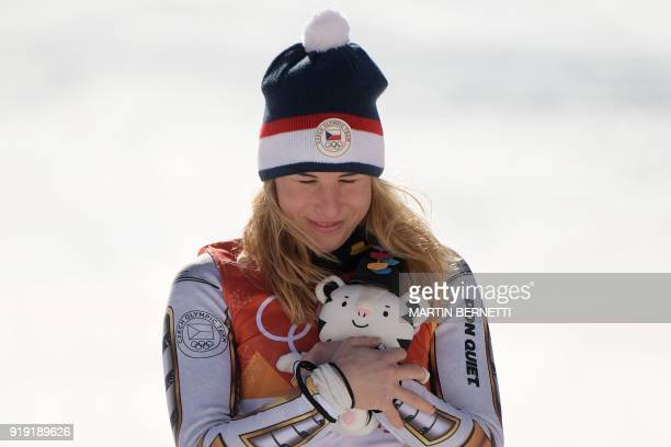 TOPSHOT Winner Czech Republic's Ester Ledecka celebrates during the victory ceremony of the Women's SuperG at the Jeongseon Alpine Center during the...