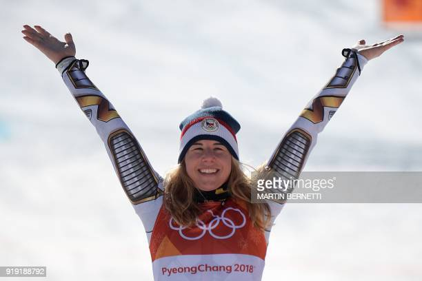 TOPSHOT Winner Czech Republic's Ester Ledecka celebrates on the podium during the victory ceremony of the Women's SuperG at the Jeongseon Alpine...