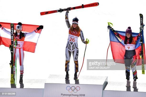 Winner Czech Republic's Ester Ledecka celebrates on the podium next to Liechtenstein's Tina Weirather third placed and Austria's Anna Fenninger Veith...