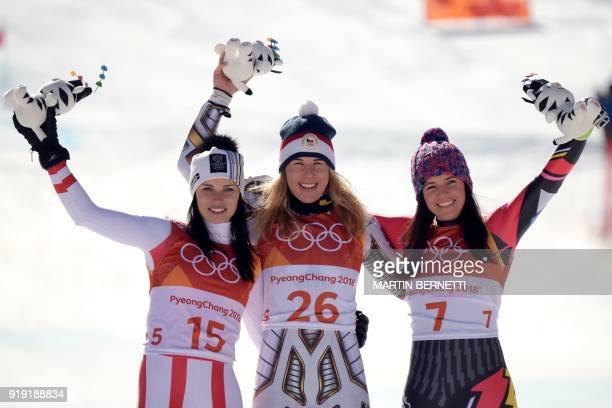 TOPSHOT Winner Czech Republic's Ester Ledecka celebrates on the podium next to Liechtenstein's Tina Weirather third placed and Austria's Anna...