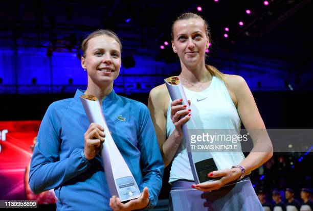 Winner Czech Republic's Petra Kvitova and Estonia's Anett Kontaveit pose with the trophies after the final match at the WTA Tennis Grand Prix in...