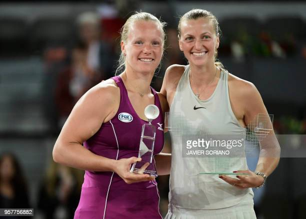 Winner Czech Republic's Petra Kvitova poses with second placed Netherlands' Kiki Bertens after their WTA Madrid Open final tennis match at the Caja...