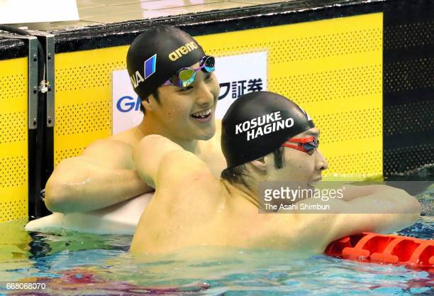 Winner Daiya Seto is congratulated by second place Kosuke Hagino after competing in the Men'ss 400m Individual Medley during day one of the Japan...
