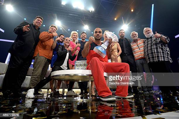 Winner David Odonkor and the other participants react the final show of Promi Big Brother 2015 at MMC studios on August 28, 2015 in Cologne, Germany.