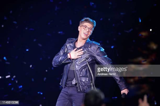 Winner Davin Herbrueggen celebrates after winning the season 16 finals of the tv competition show Deutschland sucht den Superstar at Coloneum on...