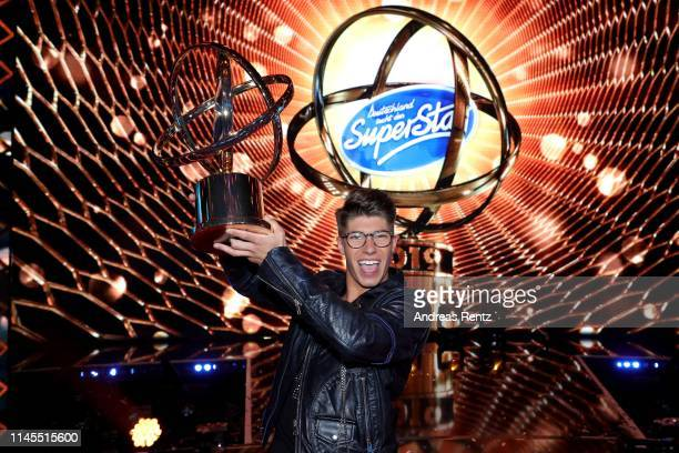 Winner Davin Herbrueggen poses with his award during the season 16 finals of the tv competition show Deutschland sucht den Superstar at Coloneum on...
