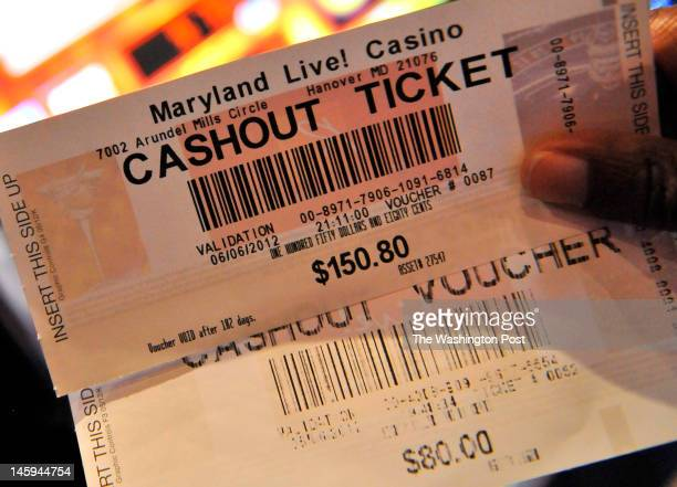 A winner displayed her cashout tickets from a slot machine on the opening night of the Maryland Live Casino at Arundel Mills on June 06 2012 in...