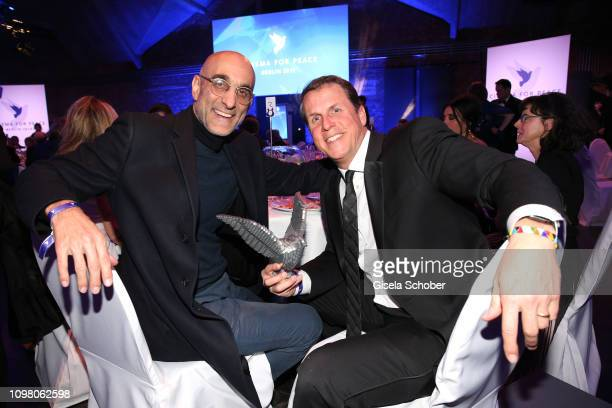 """Winner Dr. Tom Catena and Kenneth Carlson with award for the movie """"The Heart of Nuba"""" with award, during the Cinema for Peace Gala at the Westhafen..."""