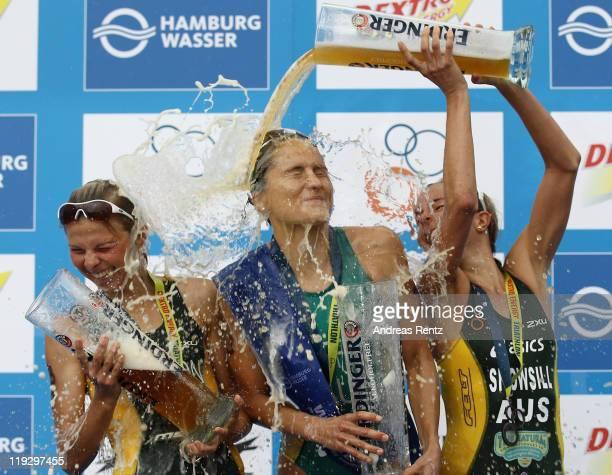 Winner Emma Moffatt of Australia is sprayed with beer by third placed Emma Snowsill of Australia as second placed Emma Jackson of Australia smiles...