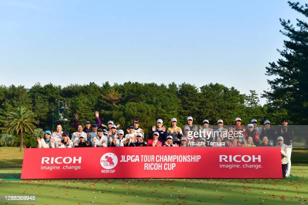 Winner Erika Hara and players pose for photographs after the final round of the JLPGA Tour Championship Ricoh Cup at the Miyazaki Country Club on...