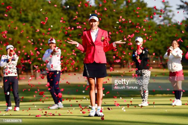 Winner Erika Hara of Japan is congratulated by fellow golfers after the final round of the JLPGA Tour Championship Ricoh Cup at the Miyazaki Country...
