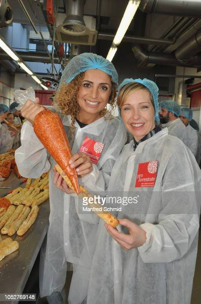 Winner Eser AriAkbaba and Martina Poel pose during the Pro Juventute charity baking event at Brotway Backzentrum Mann on October 22 2018 in Vienna...