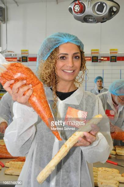Winner Eser AriAkbaba poses during the Pro Juventute charity baking event at Brotway Backzentrum Mann on October 22 2018 in Vienna Austria