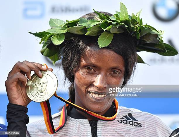 Winner Ethiopian Aberu Kebede poses on the podium with her gold medal after winning women's run of the 43rd Berlin Marathon in Berlin on September 25...