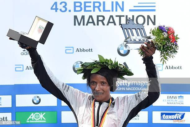 Winner Ethiopian Aberu Kebede poses on the podium with her trophy after winning the women's run of the 43rd Berlin Marathon in Berlin on September 25...