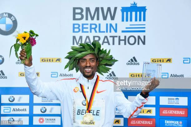 Winner Ethiopia's Kenenisa Bekele poses during the medal ceremony of the Berlin Marathon on September 29 2019 in Berlin