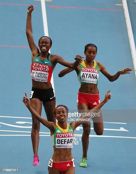 Winner Ethiopia's Meseret Defar Kenya's Mercy Cherono and third placed Ethiopia's Almaz Ayana cross the finish line during the women's 5000 metres...