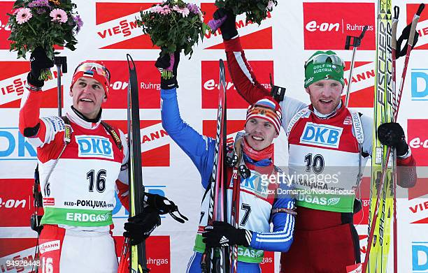 Winner Evgeny Ustyugov of Russia celebrates on the podium with second placed Roland Lessing of Estonia and third placed Simon Eder of Austria after...