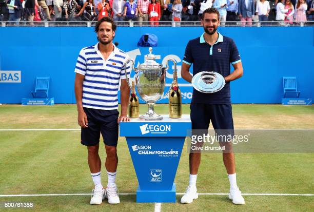 Winner Feliciano Lopez of Spain and runner up Marin Cilic of Croatia celebrate with the trophies following their mens singles final during day seven...