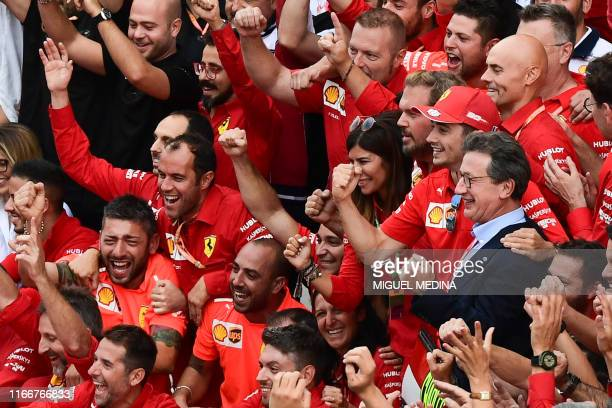 Winner Ferrari's Monegasque driver Charles Leclerc and Ferrari CEO Louis C. Camilleri celebrate with team members after the Italian Formula One Grand...