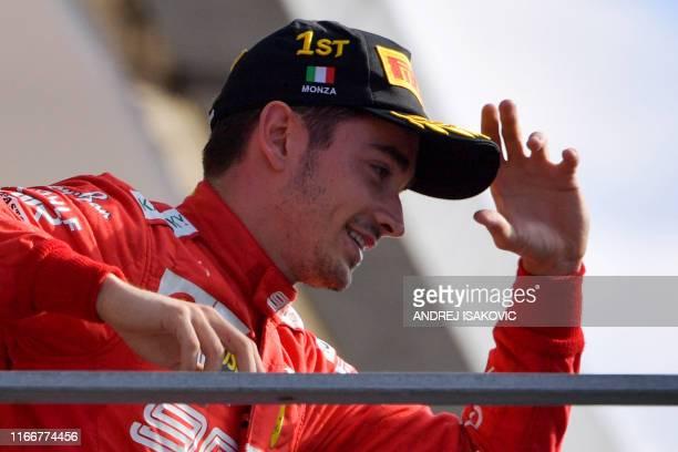 Winner Ferrari's Monegasque driver Charles Leclerc arrives on the podium after the Italian Formula One Grand Prix at the Autodromo Nazionale circuit...