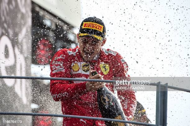Winner Ferrari's Monegasque driver Charles Leclerc celebrates with champagne on the podium after the Italian Formula One Grand Prix at the Autodromo...