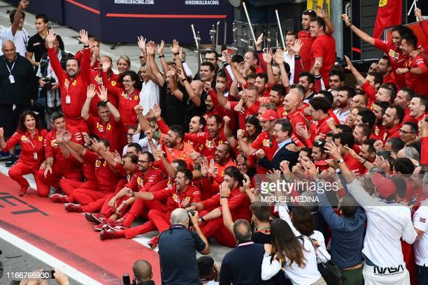 Winner Ferrari's Monegasque driver Charles Leclerc celebrates with Ferrari CEO Louis C. Camilleri, Ferrari team principal Mattia Binotto and other...