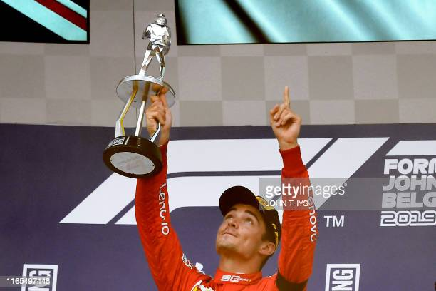 TOPSHOT Winner Ferrari's Monegasque driver Charles Leclerc holds his trophy and gestures towards the sky in tribute to late French driver Anthoine...