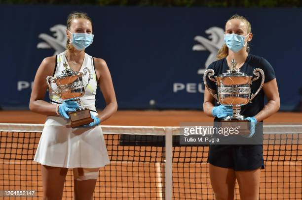 Winner Fiona Ferro of France poses with finalist Anett Kontaveit of Estonia duringthe award ceremony after the final singles tennis match during the...