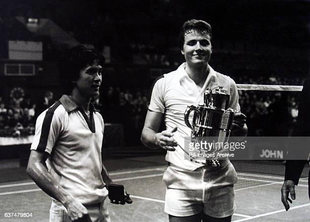 Winner Flemming Delfs holds the trophy after defeating Liem Swie King