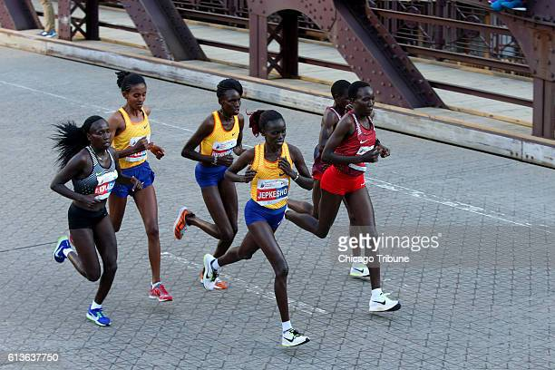 Winner Florence Kiplagat left and other women runners participate in the Bank of America Chicago Marathon on Sunday Oct 9 2016 in Chicago Ill