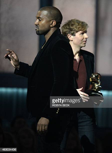 Winner for Album Of The Year Beck reacts as Kanye West appears on stage at the 57th Annual Grammy Awards in Los Angeles February 8 2015 AFP PHOTO /...