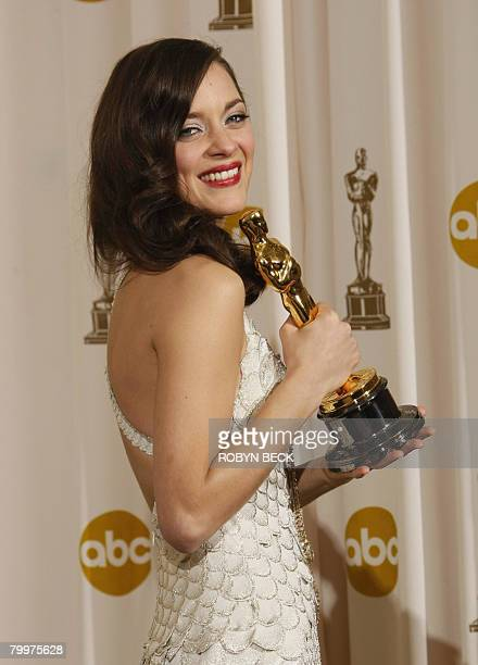 Winner for Best Actress Marion Cotillard poses with the trophy during the 80th Annual Academy Awards at the Kodak Theater in Hollywood California on...