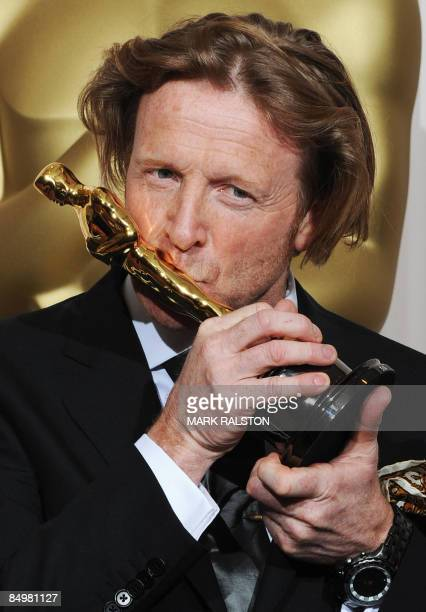 Winner for Best Cinematography in 'Slumdog Millionaire' Anthony Dod Mantle kisses his Oscar at the 81st Academy Awards at the Kodak Theater in...