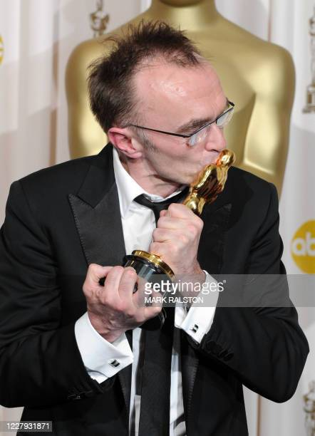"""Winner for Best Director for """"Slumdog Millionaire"""" Danny Boyle kisses his Oscar at the 81st Academy Awards at the Kodak Theater in Hollywood,..."""