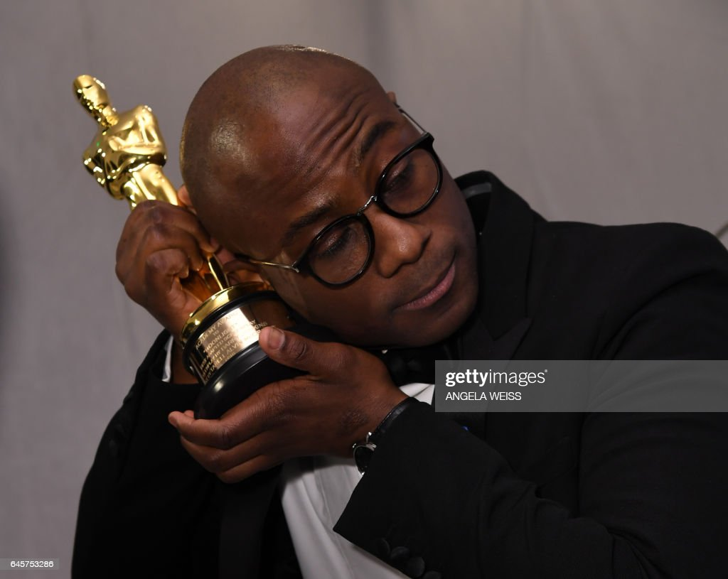 TOPSHOT - Winner for Best Director 'Moonlight' Barry Jenkins holds his trophy at the 89h Annual Academy Awards Governors Ball in Hollywood, California, on February 26, 2017. /
