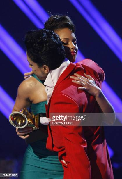 2008 winner for Best Female RB Vocal Performance Alicia Keys accepts her award from Prince at the 50th Grammy Awards in Los Angeles on February 10...